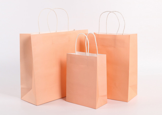 Beige color kraft paper bags with handle