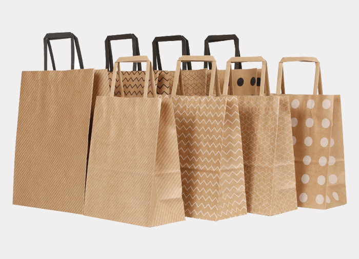 Wholesale cheap Kraft printed paper gift bags with flat paper handles
