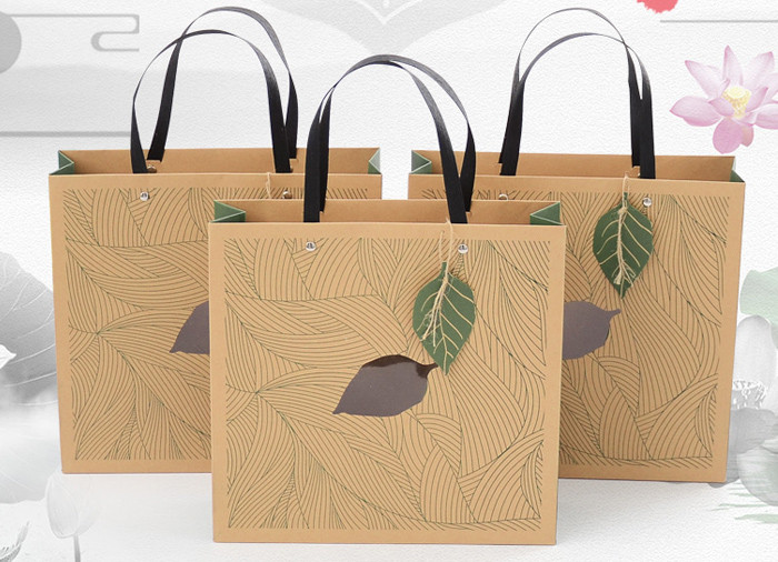 Luxury green color printed kraft gift bags with paper handles wholesale