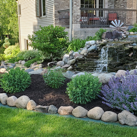 Dark Chocolate Brown Mulch with Boulders
