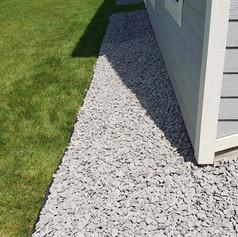 1.5 Inch Granite Rock Perimeter with Dig Free Edging