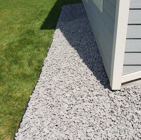 1.5 Inch Granite Rock Perimeter with Dig Free Edging