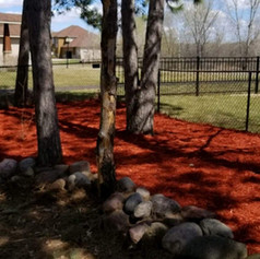 Red Mulch with Boulder Wall