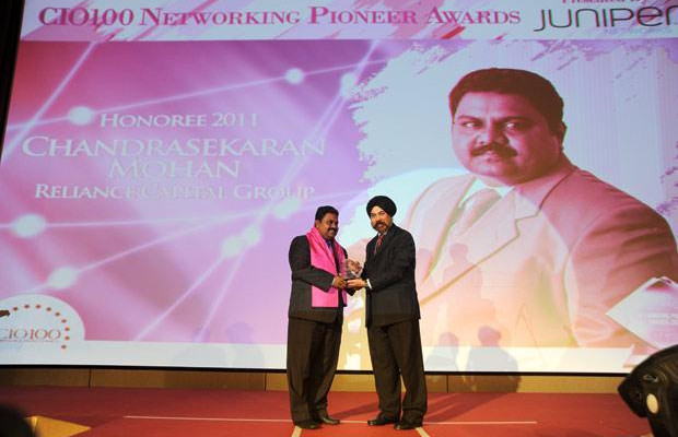 Networking Pioneer: Chandrasekaran Mohan, CTO of Reliance Capital receives the CIO100 Special Award for 2011 from Ravi Chauhan, MD, India and SAARC, Juniper Networks