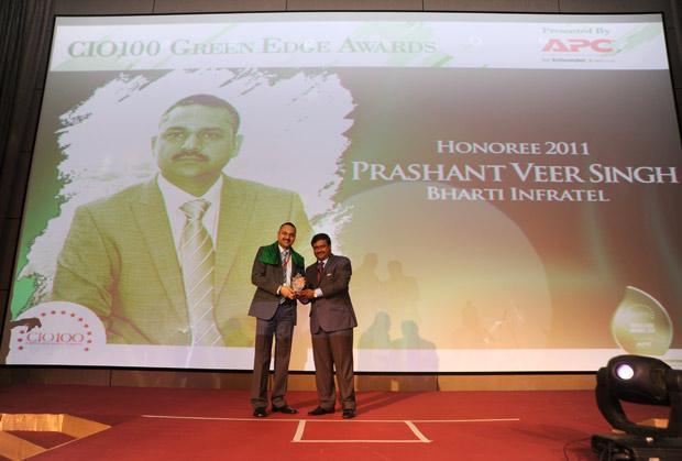 Green Edge: Person, designation of company receives the CIO100 Special Award for 2011 from Shrinivas Chebbi, Country GM and VP, APC by Schneider Electric.