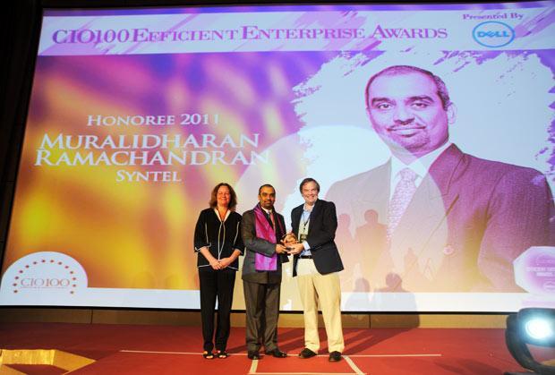 Efficient Enterprise: Muralidharan Ramachandran, CIO, Syntel International receives the CIO100 Special Award for 2011 from  Sally Stevens, VP, PG Platform Marketing, Dell and Kevin Noreen, Marketing Director, System Management, Dell