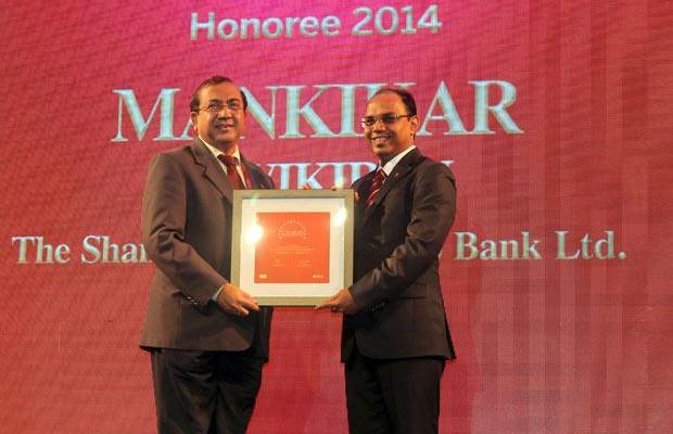 The Dynamic 100: Ravikiran S Mankikar, Chief GM-IT of The Shamrao Vithal Co-operative Bank receives the CIO100 Award for 2014