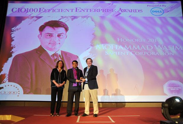Efficient Enterprise: Mohammad Wasim, Director & Global Infrastructure Lead, Sapient Corporation receives the CIO100 Special Award for 2011 from Sally Stevens, VP, PG Platform Marketing, Dell and Kevin Noreen, Marketing Director, System Management, Dell