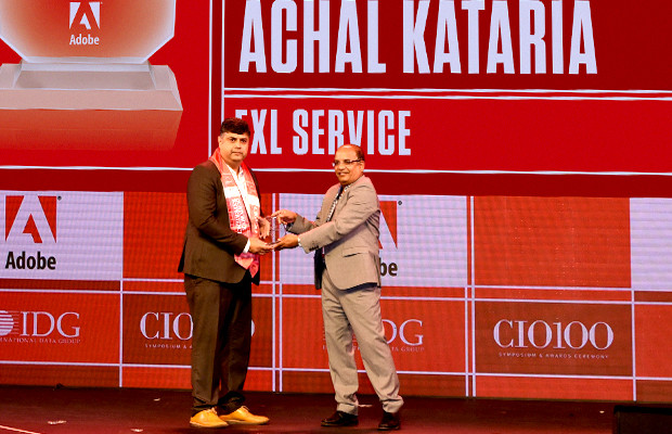 Customer Experience Icon: Achal Kataria, Vice President and Global Head of Technology, EXL Service Holdings receives the CIO100 Special Award for 2019 from Narsimha Rao, Sales Director, Adobe