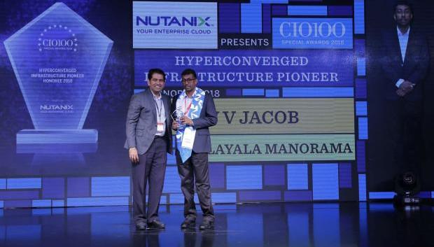 V V Jacob, General Manager, Malayala Manorama, receives the CIO100 special award for 2018 from Sunil Mahale, VP & MD Nutanix India