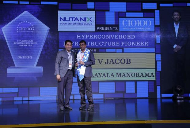 V V Jacob, General Manager, Malayala Manorama, receives the CIO100 special award for 2018 from Sunil Mahale, VP & MD Nutanix India