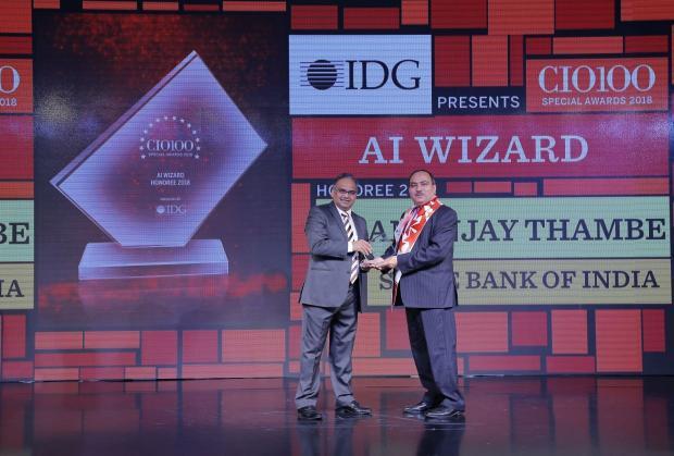 AI Wizard: Shivkumar Bhasin, on behalf of Dhananjaya Tambe, Deputy MD and CIO of State Bank of India, receives the CIO100 special award for 2018