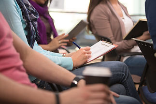 Close up view of student taking notes du