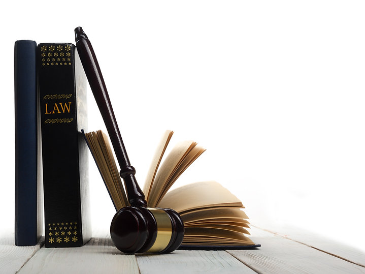 Law concept - Open law book with a woode