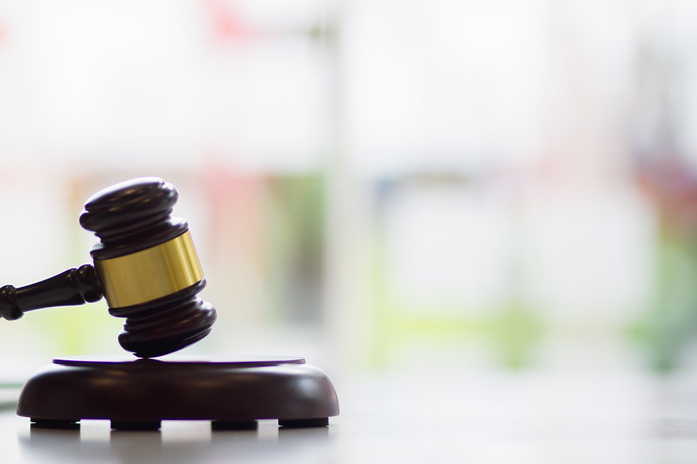Law Gavel window with blurry image in background