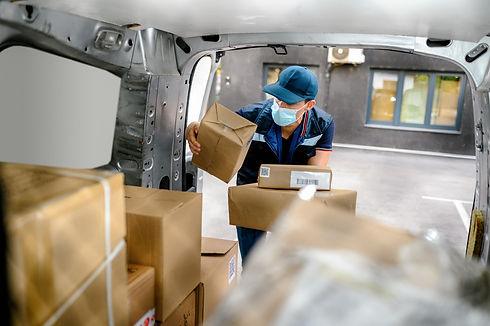 Delivery driver handling parcels