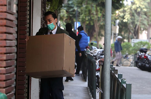 Courier holding a package