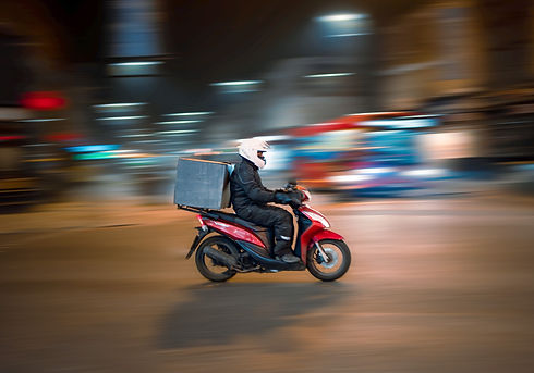 Delivery driver on a moped