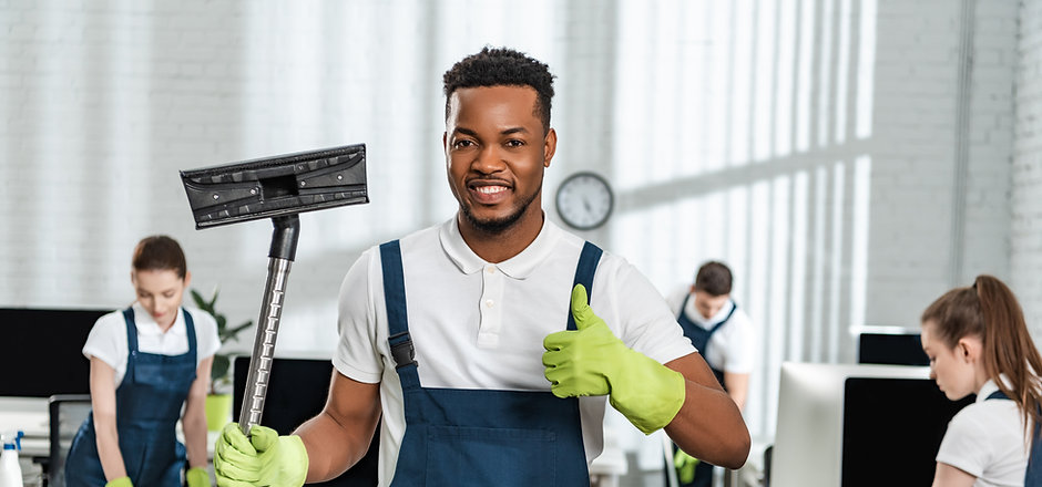 smiling african american cleaner holding
