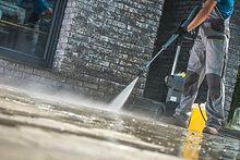 Canva-Men-Washing-Driveway-1024x683.jpg