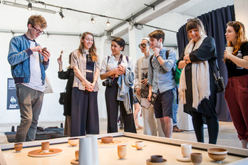 Ekaterina explains her project to visitors of Milan Design Week