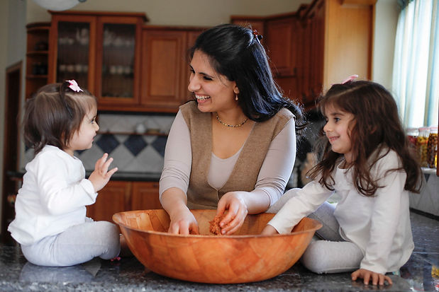 Reem Kassis and her two daughters cooking