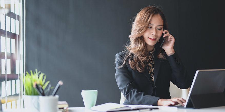 attractive-asian-businesswoman-speaking-