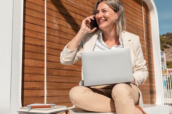 smiley-woman-working-laptop_23-214876541