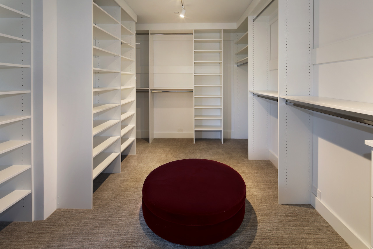 Dressing room & walk-in closet in downstairs master.