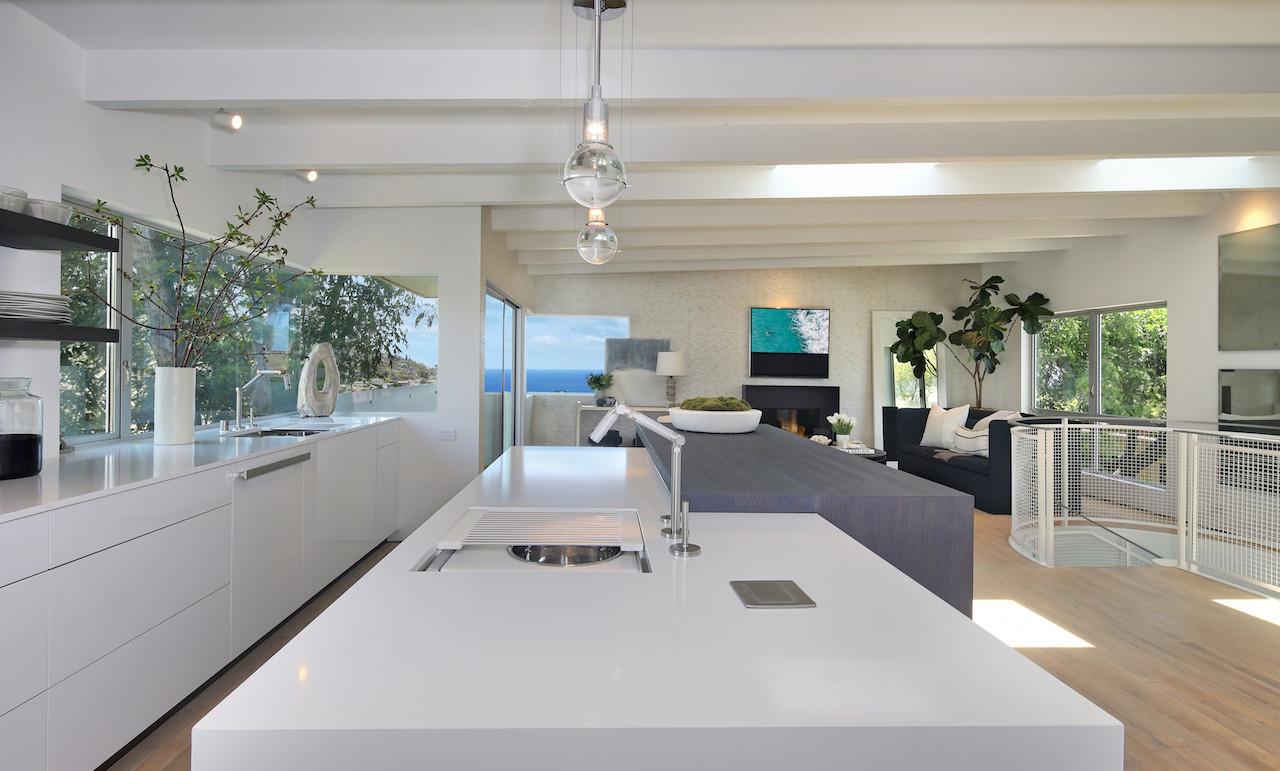 Pental quartz counters and Eggersman cabinets.