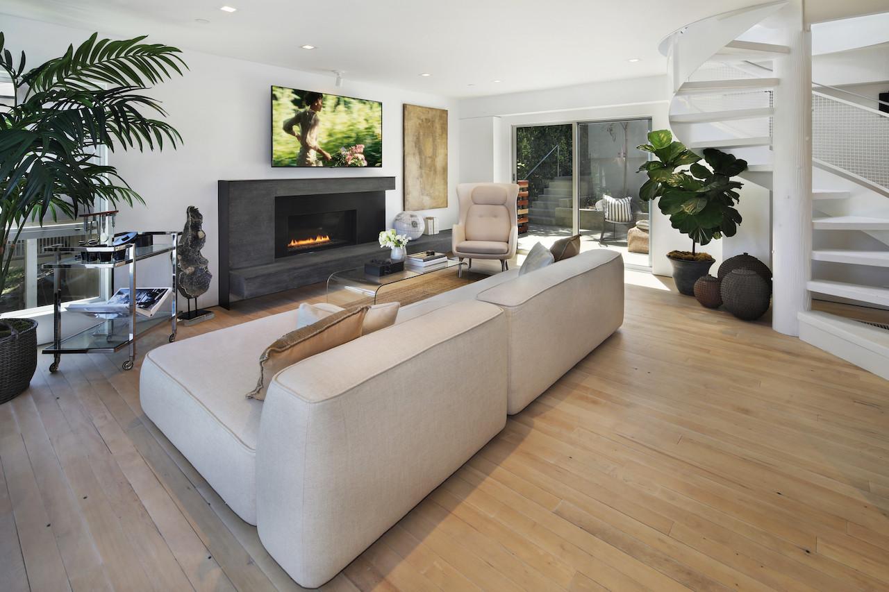 C ustom Spark Fireplaces on both levels.