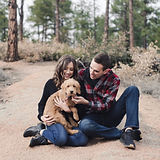 Couple playing with their dog photo shoot