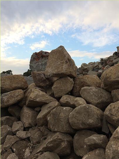 Cape Cod Stoneworks Excavator Stone