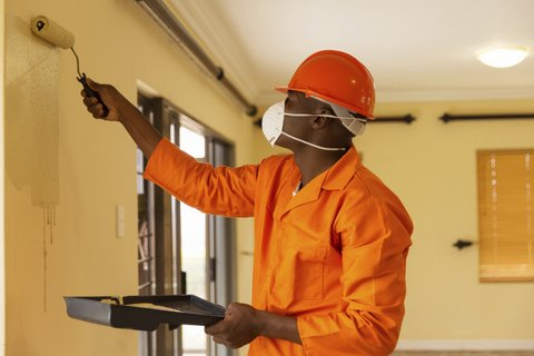african-construction-worker-painting-the
