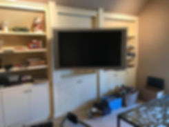Wall mounted TV in excercise room