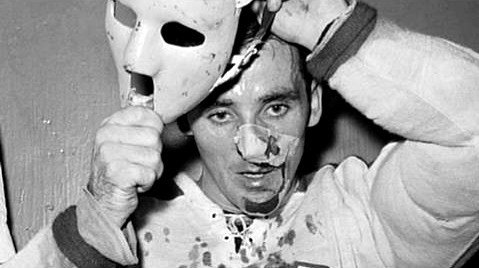 Jacques Plante donning his mask