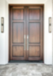 We custom designed the front doors to create a dramatically simple entrance. Rocky Mountain Hardware, UltraLight Sconces.