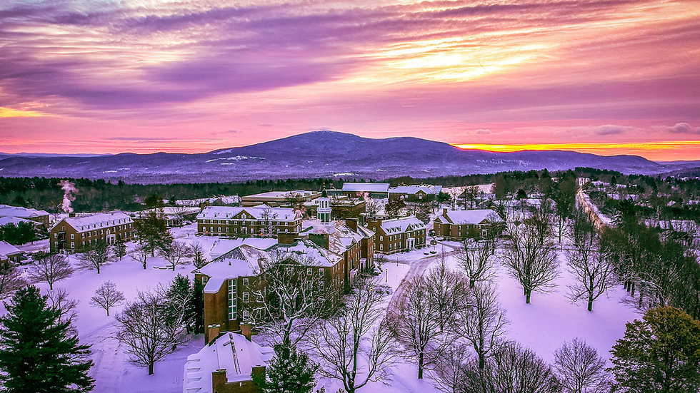 A limited edition print of a beautiful early winter scene as the sun rises near Colby-Sawyer in New London, NH with Mt Kearsa