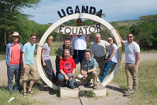Braden Swab (right) with a team of volunteer architects and engineers at the equator in Uganda