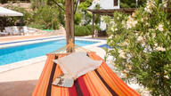 Relax in the hammock by the  swimming pool