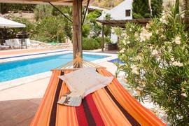 El Molino del Conde: Hammock by the swimming pool