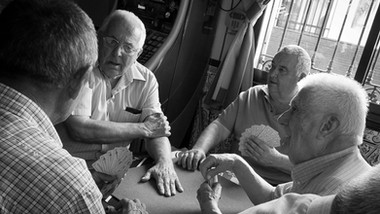 Locals playing cards in one of the village bars