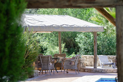 El Molino del Conde: Shaded terrace by the swimming pool