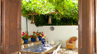Drinks in the vine-shaded courtyard