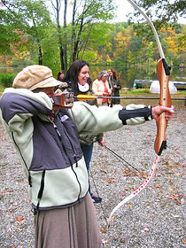 old woman shooting archery