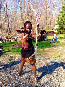 black woman with bow and arrow