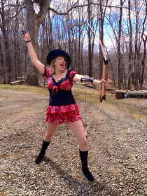 white woman with cowboy hat and bow and arrow