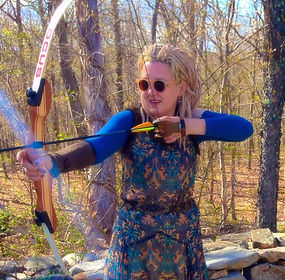 white woman with bow and arrow