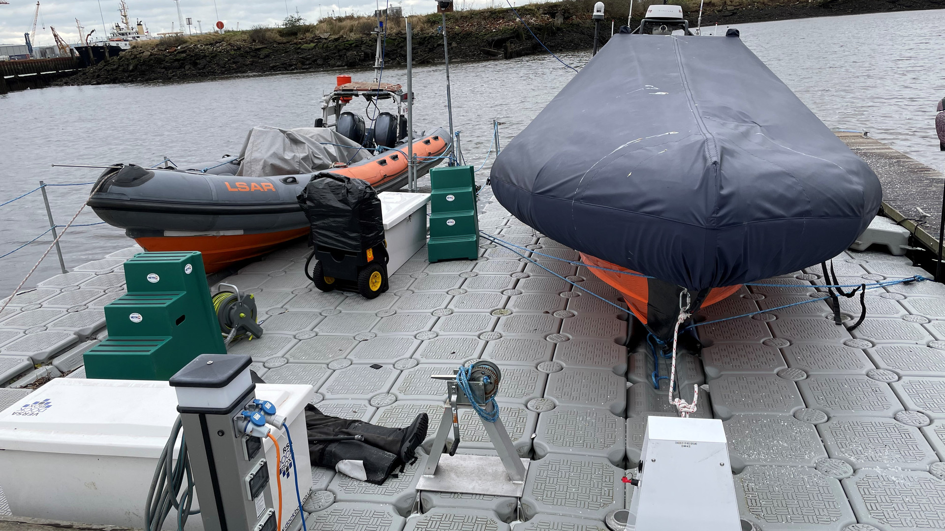 Both Lifeboats stored on our Floating Pontoon.  We hope to enclose this floating pontoon inside a Boathouse.