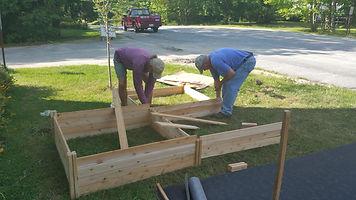 volunteers building garden beds